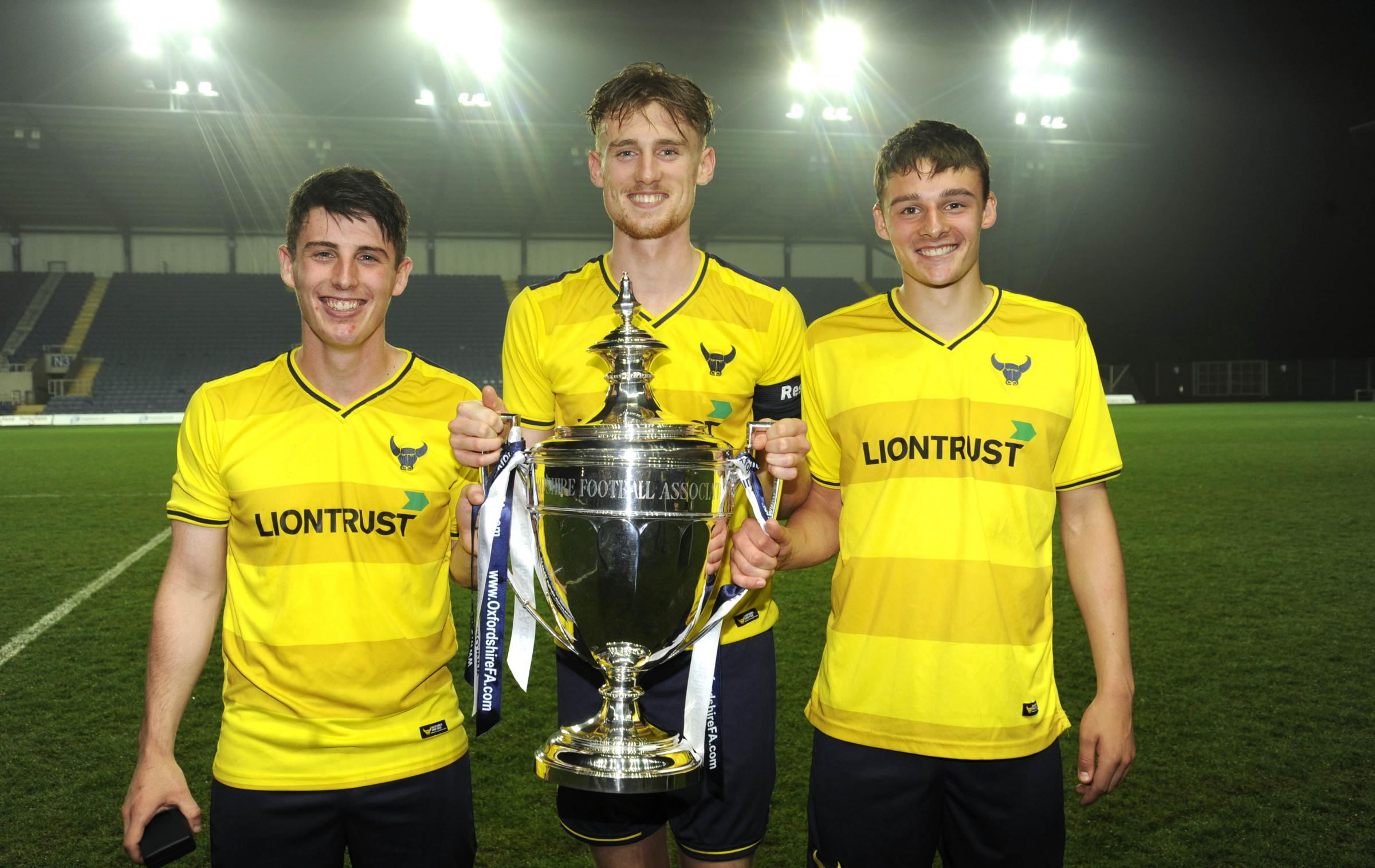 Skipper Robbie Cundy is flanked by goalscorers James Roberts (left) and George Jeacock as Oxford United lifted the Oxfordshire Senior Cup Picture: David Fleming