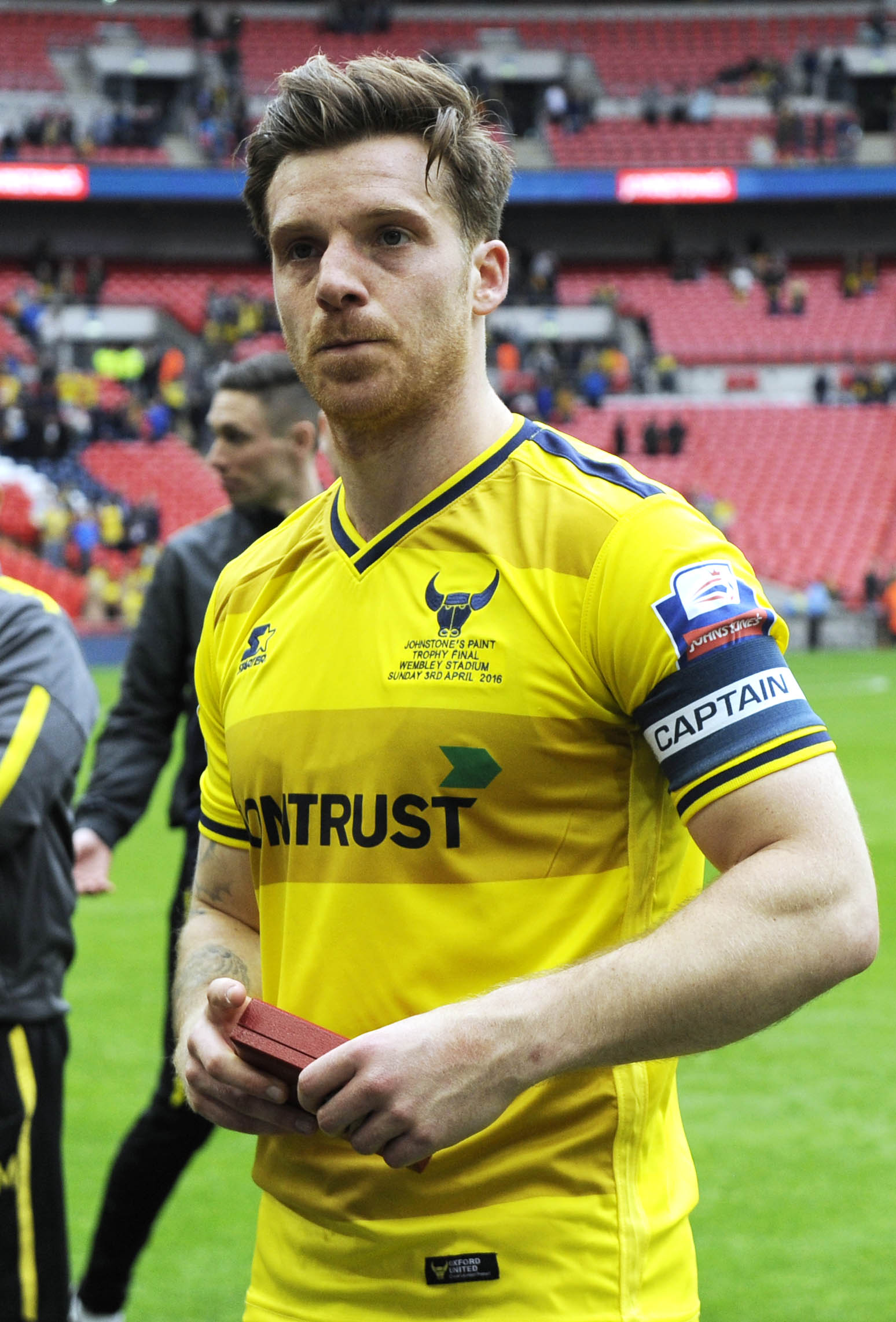 Johnny Mullins, pictured as captain after United's Johnstone's Paint Trophy defeat at Wembley, has been told he can leave the club