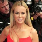 Oxford Mail: Amanda Holden lies naked on a bed of cabbages for Peta