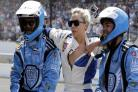 Lady Gaga goes for a drive with Mario Andretti at the Indy 500