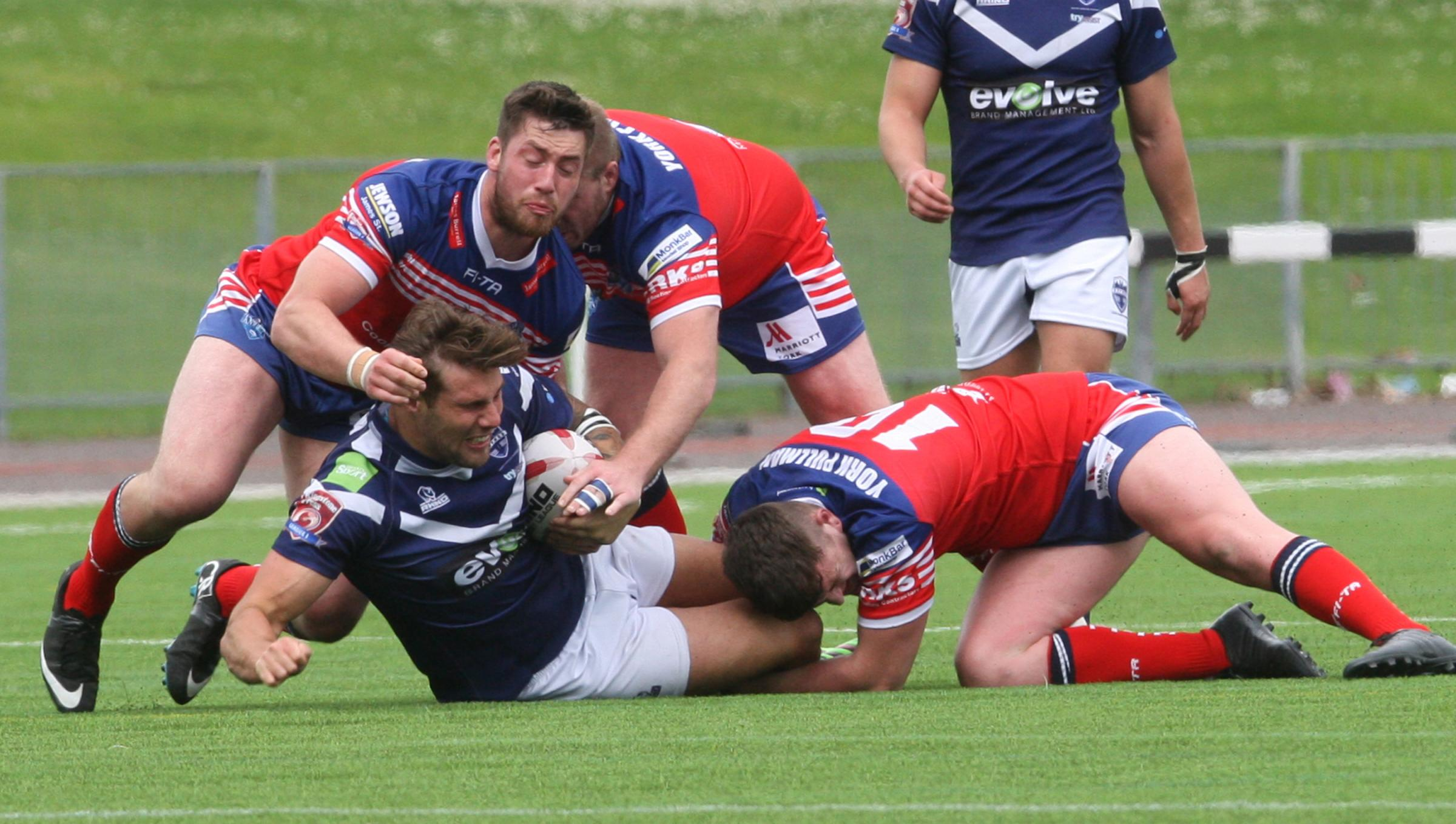 Oxford RL's Aaron Nicholson finds himself surrounded by three York City Knights tacklers Picture: Steve Wheeler