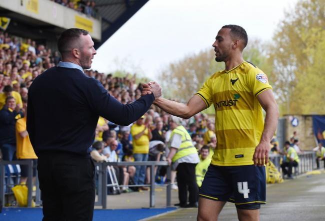 Michael Appleton shakes the hand of Kemar Roofe as he comes off in Oxford United's promotion-winning victory over Wycombe