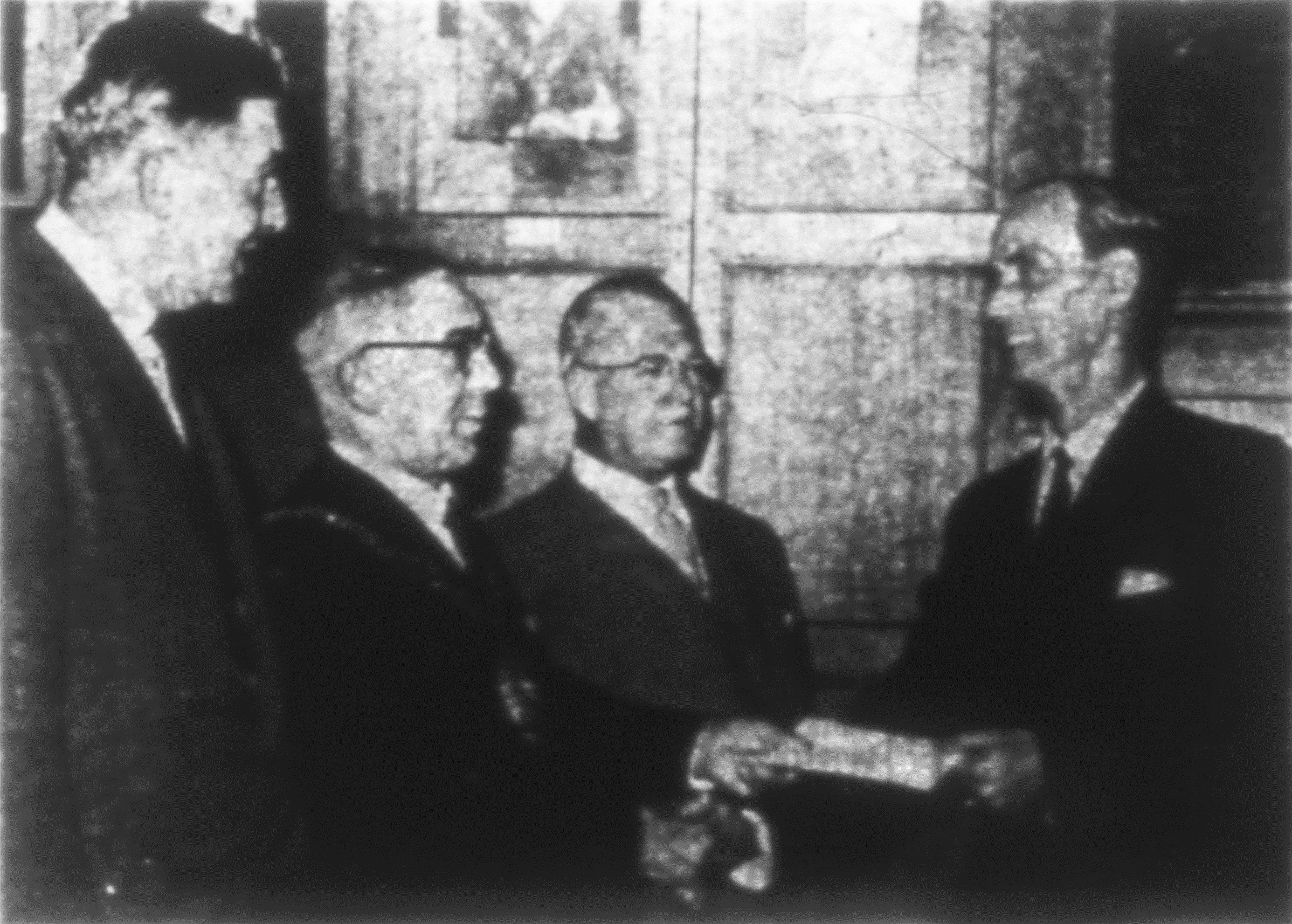 Stationmaster James Miller, right, receives a cheque from the Mayor of Oxford, Alderman Evan Roberts, when he retired in 1962