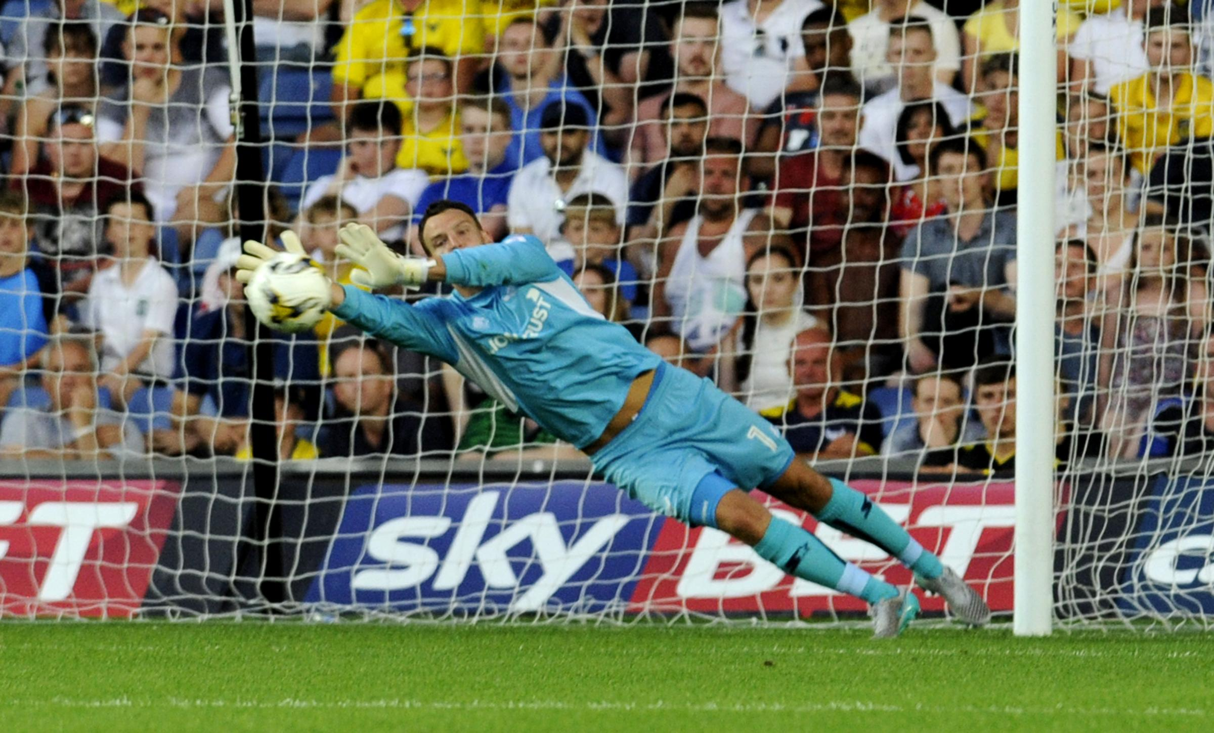 Simon Eastwood makes a spectacular save to deny Leicester's Ahmed Musa