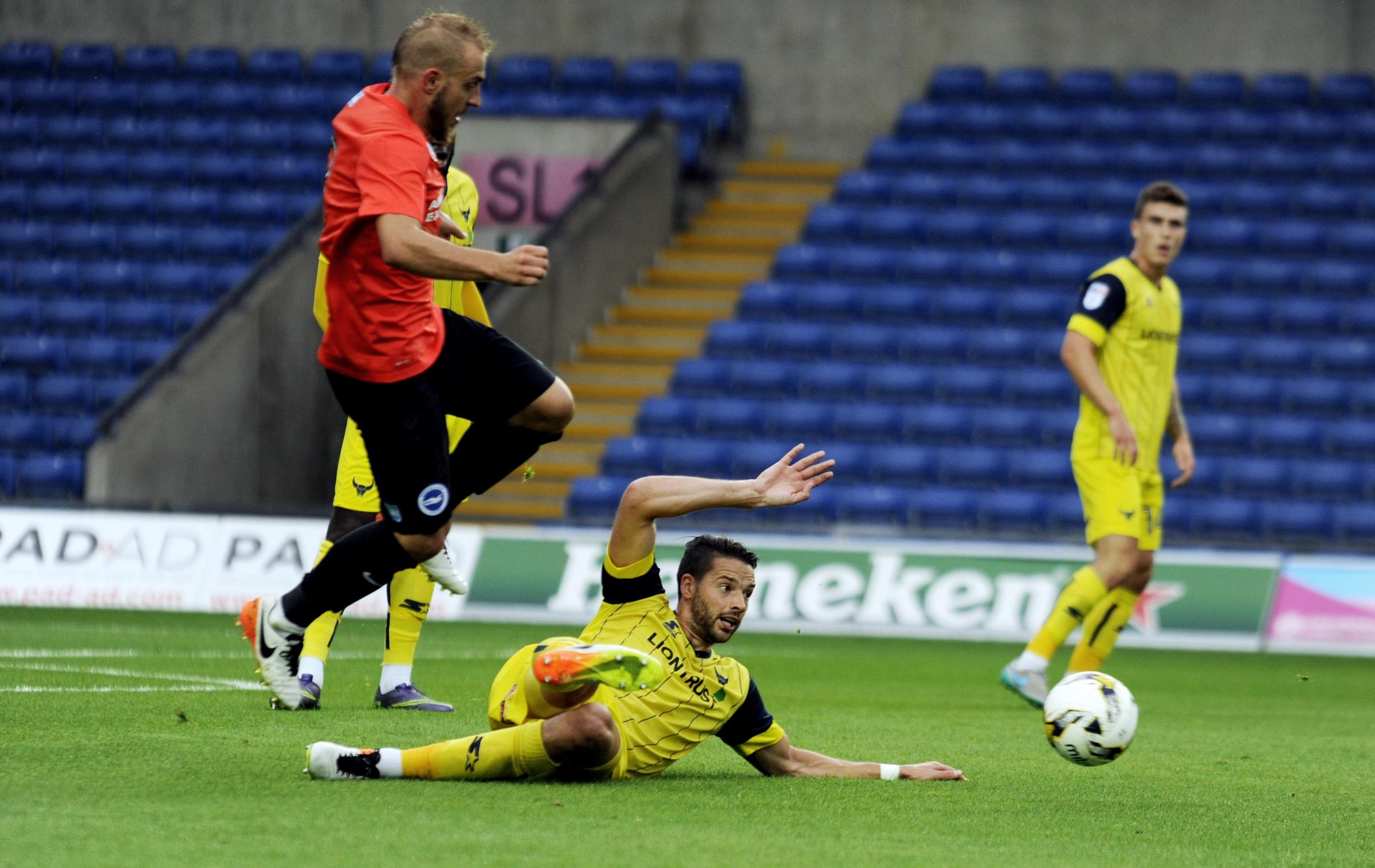 Oxford United's Aaron Martin slides in to clear from Brighton's Jiri Skalak in the first half