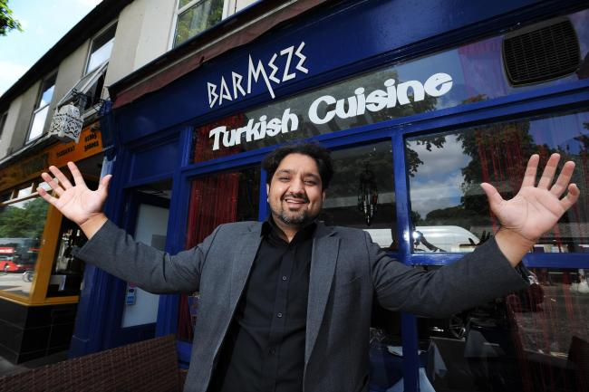 Bar Meze owner Yasir Hanif outside his restaurant. Pic: Jon Lewis.
