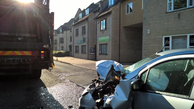 A car and bin lorry crashed in Witney