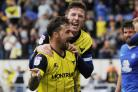Chris Maguire, pictured celebrating with skipper John Lundstram (back) after scoring the winning penalty for Oxford United against Peterborough, wants to keep Sheffield United fans quiet in his home town Picture: David Fleming