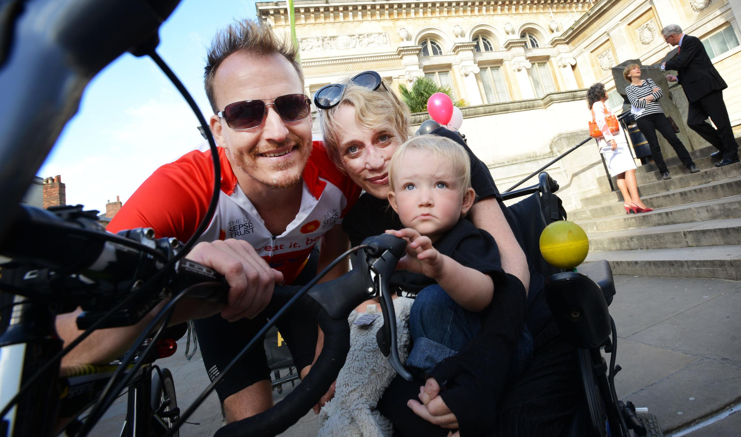 Christoph Bachhuber and Liz Frood with son Emeran ahead of the cycling challenge