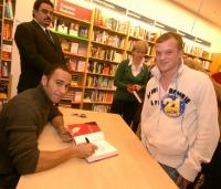 SIGN, PLEASE: Lewis Hamilton meets F1 fan Lewis Doyle, from Bicester, who got the perfect birthday present