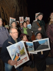 Boatyard protesters, including author Philip Pullman, second right, are pictured outside the town hall before tonight's meeting