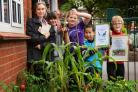 Outdoor Learning Officer Julie Norris with East Oxford Primary School children by winning Oxford In Bloom flower display.L-R Julie Norris, Stells Pataridou (9), Elsie Williams (9), Peter Luo (6) and TJ (Thomas) Williams (7).