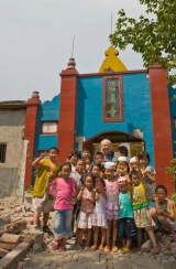 John Henshall with children in Changdu