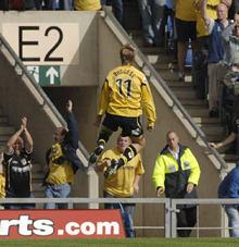 Andy Burgess celebrates his goal