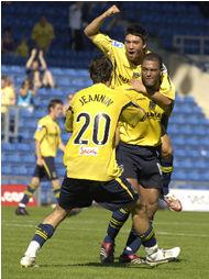 Phil Trainer celebrates his second goal with Danny Roase and Alex Jeannin