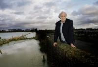 Oxford Mail: Farmer John Hook with flooded fields at Cote, near Bampton
