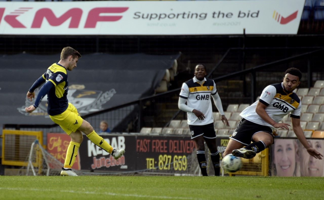 Dan Crowley slots home to put Oxford United 2-0 ahead in the first half  Pictures: David Fleming