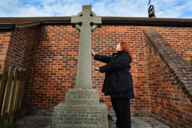 Reverend Hannah Reynolds of St Peter's Church in Didcot standing next to the Northbourne Memorial