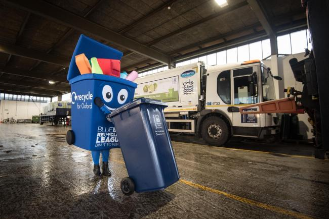 Phil the Bin, Oxford City Council's recycling mascot, at a depot with the recycling trucks. Picture: Andrew Walmsley
