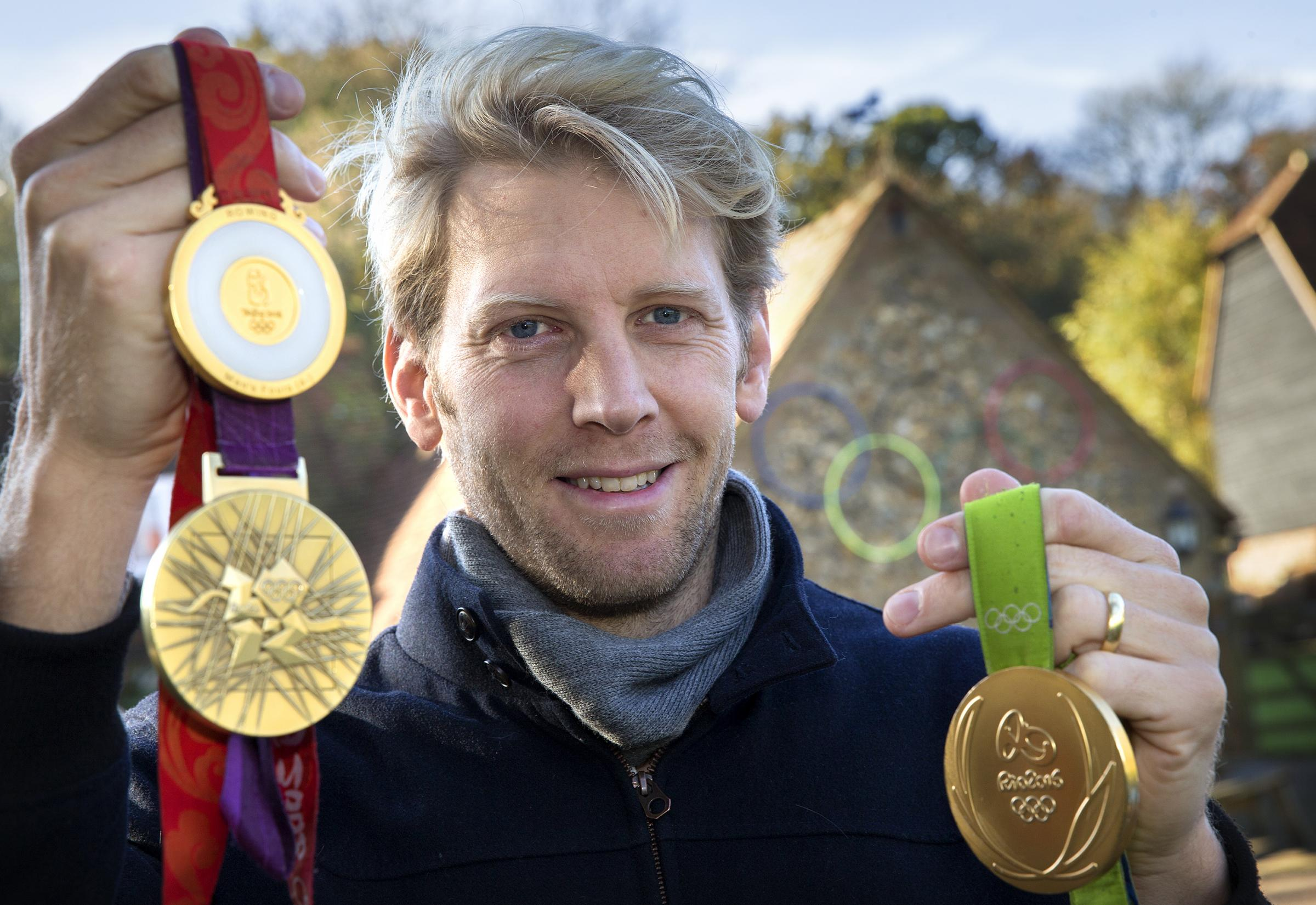 WHAT A CAREER: Andy Triggs Hodge with the Olympic gold medals he won at Beijing, London and Rio before retirement           Picture: Damian Halliwell