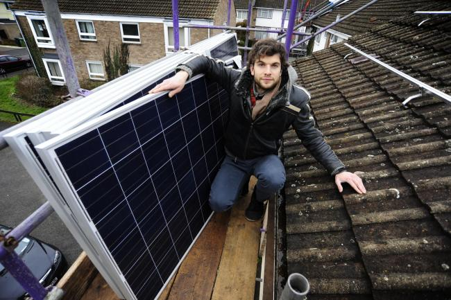 Project ERIC leader Andy Edwards, with solar panels in Rose Hill. Picture by: Copyright: David Fleming.
