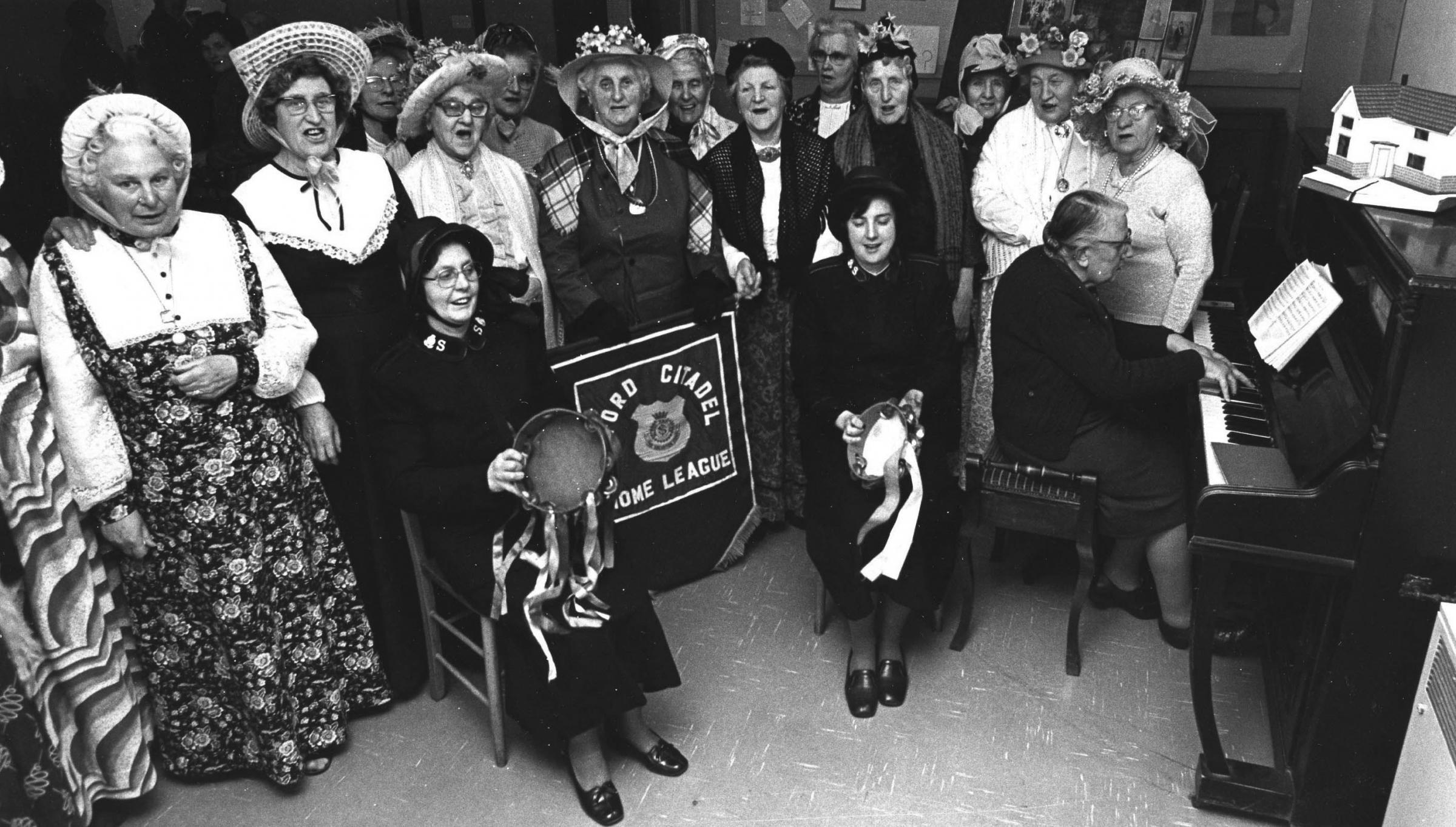 In February 1977, members of Oxford's Salvation Army Home League gathered around the piano for a sing-song to celebrate the 70th birthday of the home league
