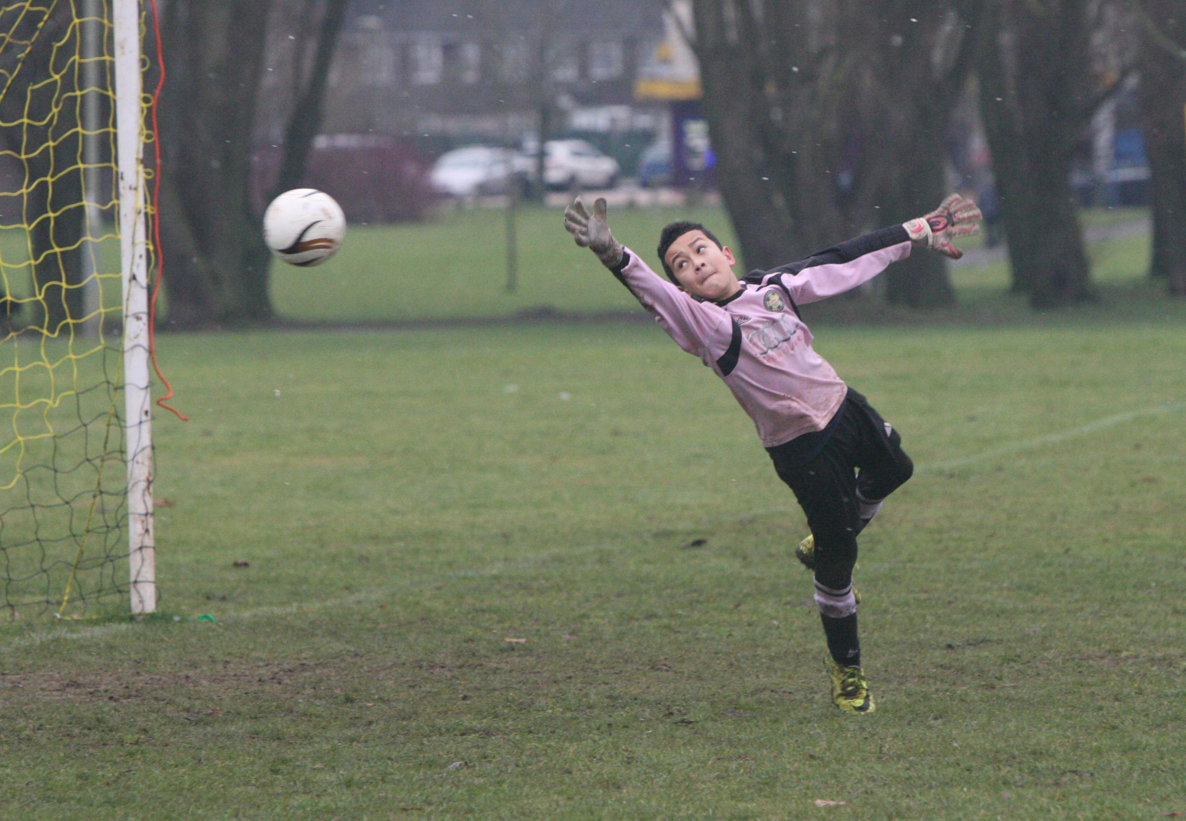 Oxford Blackbirds Under 13 keeper Mikolaj Thompson makes a flying save to deny Horspath