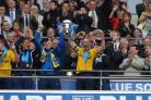 James Constable lifts the Blue Square Bet Premier play-off trophy after Oxford's win over York in 2010 to secure promotion back into the Football League