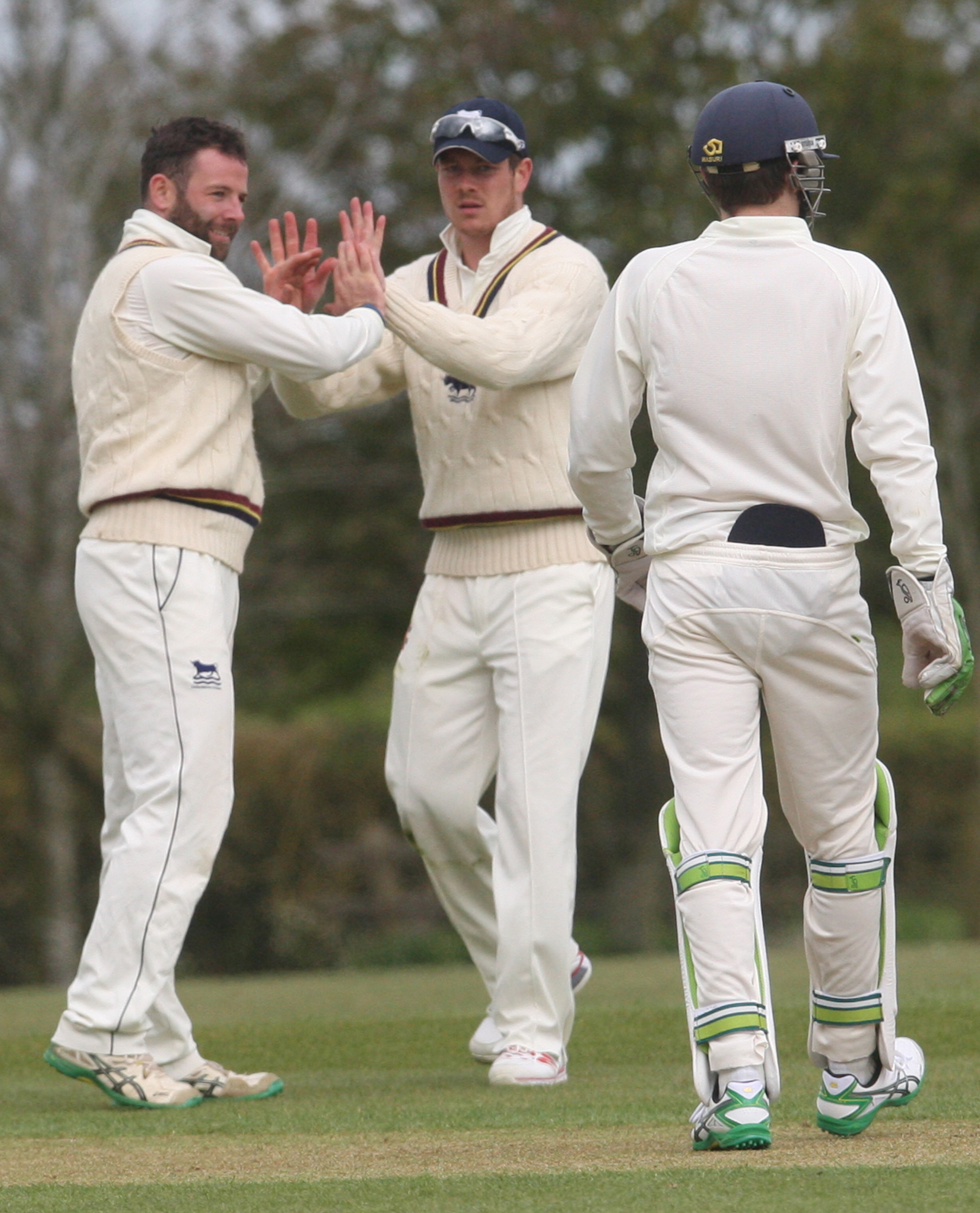 VICTIM: Oxon's Luke Ryan (left) celebrates after taking the wicket of Shelvin Gumbs                                Picture: Steve Wheeler