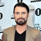 Oxford Mail: New game show Babushka will not replace The Chase, insists host Rylan Clark-Neal