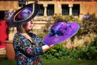 Lizzie Hurst with her hats outside St Barnabas Church in Jericho. Lizzie is a hatmaker who will be displaying them at St Barnabas Church in Jericho next month as part of the Artweeks festival. Picture Richard Cave