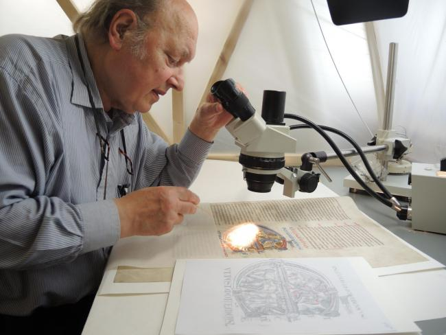 Christopher Clarkson fixing loose pigment on a miniature from the Winchester Bible. Photograph: Jane Eagan/Winchester Cathedra