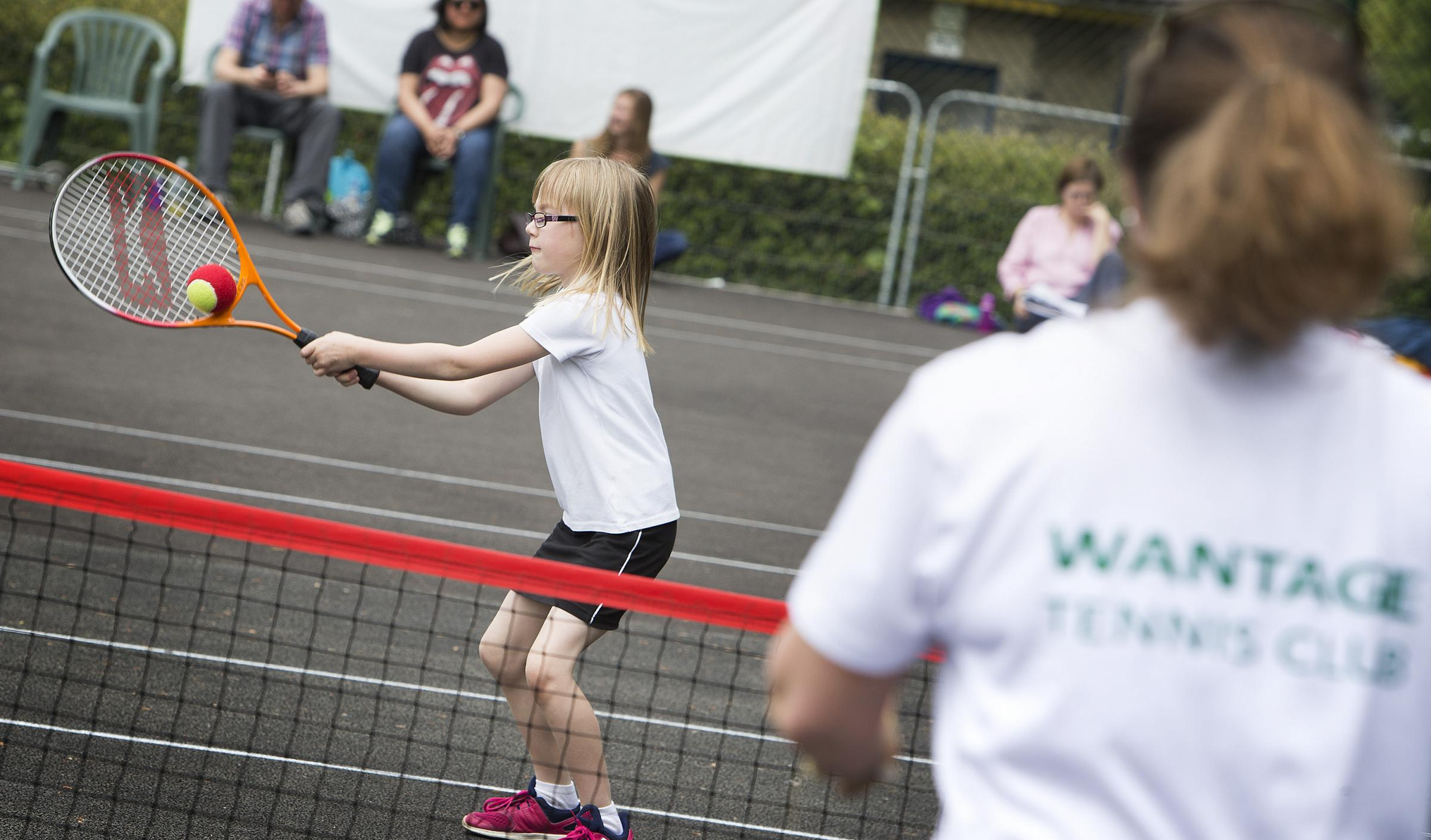 Have-a-go fun at Wantage Tennis Club: six-year-old Ruby Gniadek-Pitt working on back-hand technique with junior liaison officer Sue Cronin. Picture by Damian Halliwell