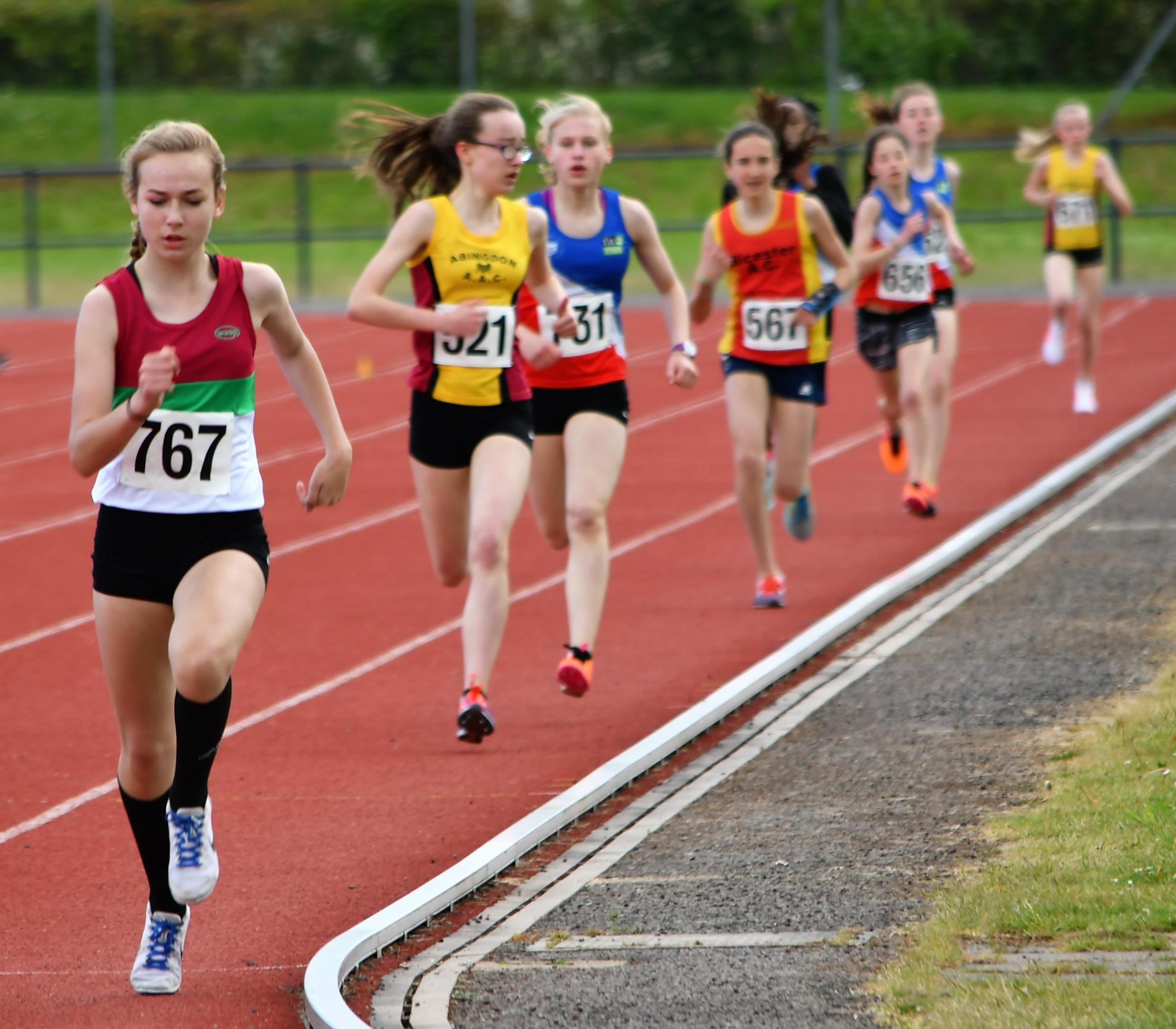 LEADING THE WAY: Alex Scrivener, of Banbury Harriers, clinched double middle-distance gold at Horspath, with Abingdon's Mieke Bedlington and Oxford City's Daisy Palmer filling the other two positions in the under 15 girls' 800m and 1,500m