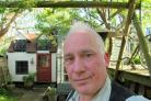 Children's author Ted Dewan pictured with Philip Pullman's former shed in his Summertown garden