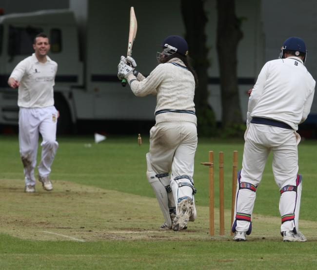 CASTLED: Wootton & Boars Hill's Billy Webb is bowled by George Seacole in Witney Swifts' victory