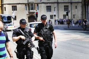 TERROR THREAT: Armed police were deployed in the city centre yesterday, with two firearms officers pictured outside the Ashmolean Museum in Beaumont Street, above, and later at Oxford Railway Station Picture by Ed Nix