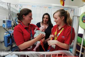 Children's Hospital play specialists Emily Hodgekinson, left, and, Klarissa Burrows with seven-month-old Billy Kearns and his mum Laura..DATE: 26.05.2017..Pic by Jon Lewis......