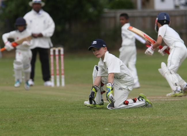 Oxfordshire Wessex Under 10s' wicket-keeper Ben Ferrett looks on as London School pile on the runs in their 110-run victory Picture: Steve Wheeler
