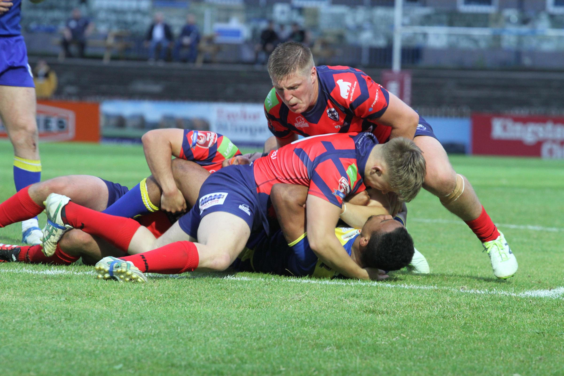 HARD WORK: Oxford RL do all they can to stop Doncaster in their tracks during a 34-16 defeat in Kingstone Press League One Picture: Simon Hall
