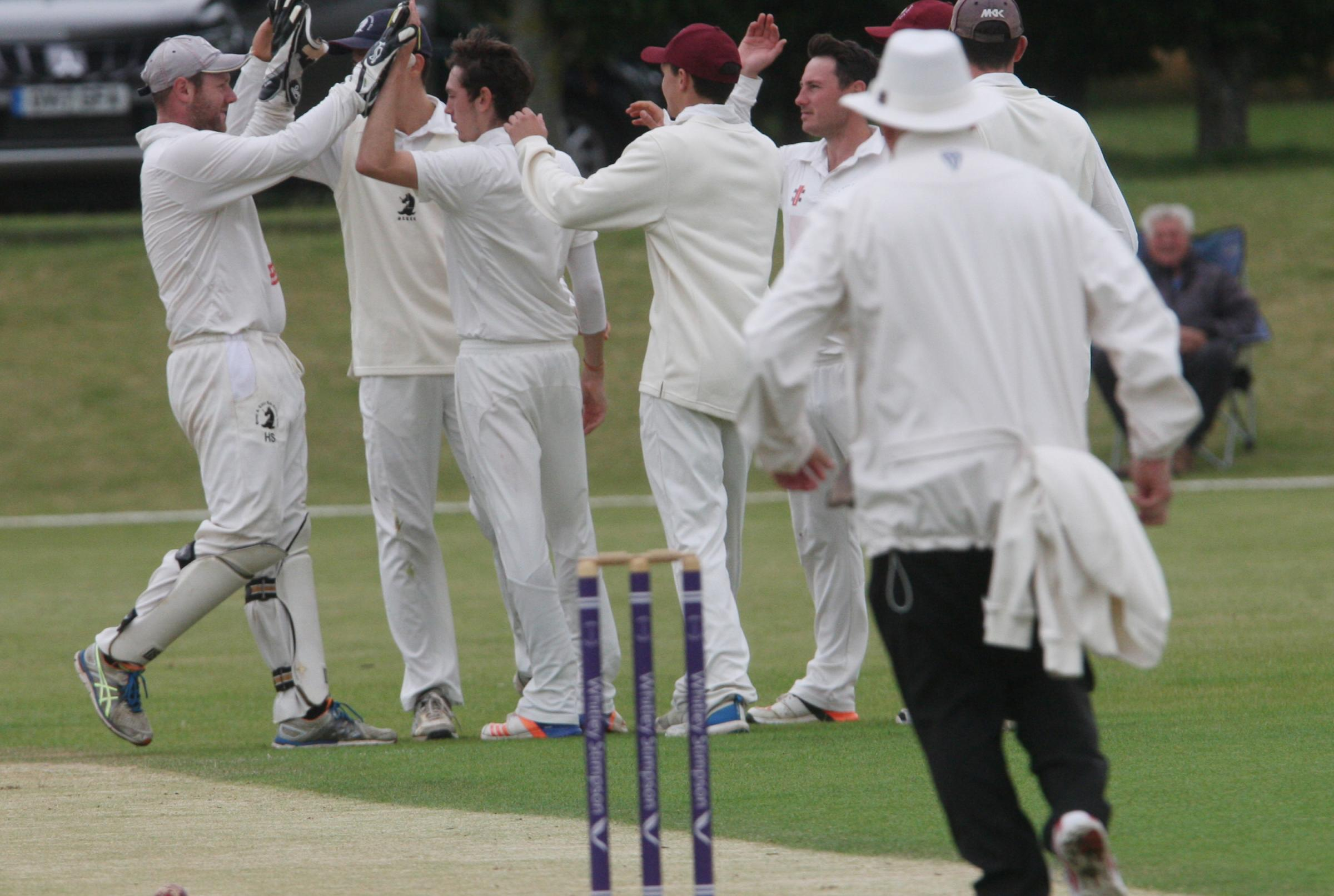 SUPER START: Great & Little Tew players celebrate after Lawrence Brock dismissed Banbury opener Ollie Clarke for a duck                                                                                                                              Pictures: