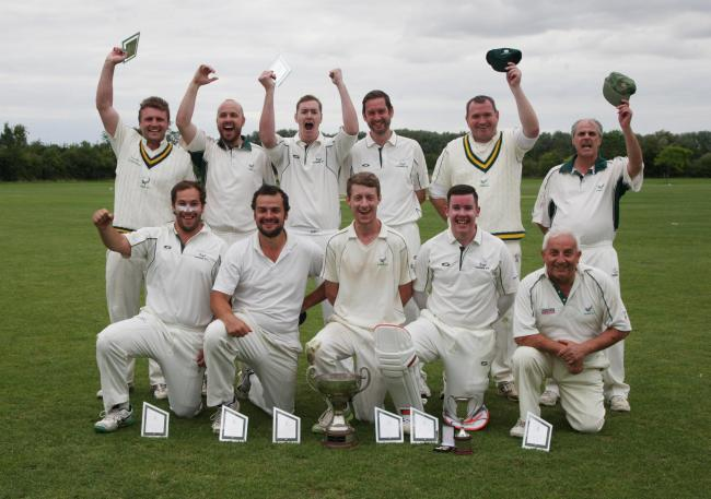 Combe celebrate their victory in the Steve Dixon Cup Picture: Steve Wheeler