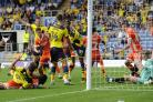 GOAL! Gino Van Kessel (No 39) is in the right place to fire Oxford United into a 75th-minute lead on Saturday Picture: David Fleming
