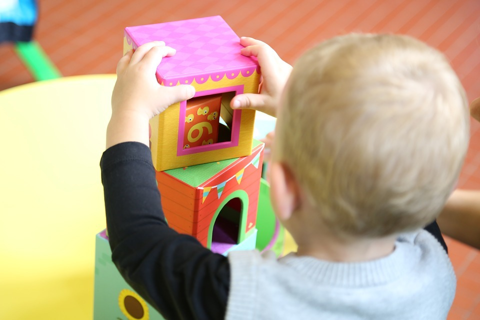 Child playing with toys at nursery (stock image)