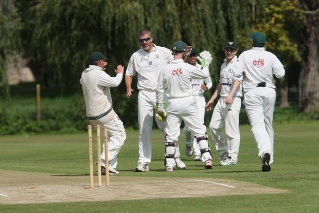 EARLY WICKET: Abingdon Vale celebrate as Graham Charlesworth (wearing sunglasses) dismisses Peter King Picture: Steve Wheeler