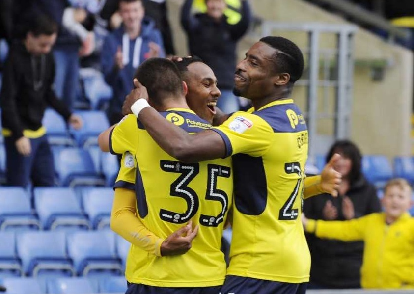 Rob Hall (centre) is congratulated by Canice Carrol (left) and Jon Obika after scoring Oxford United's third goal  Picture: David Fleming
