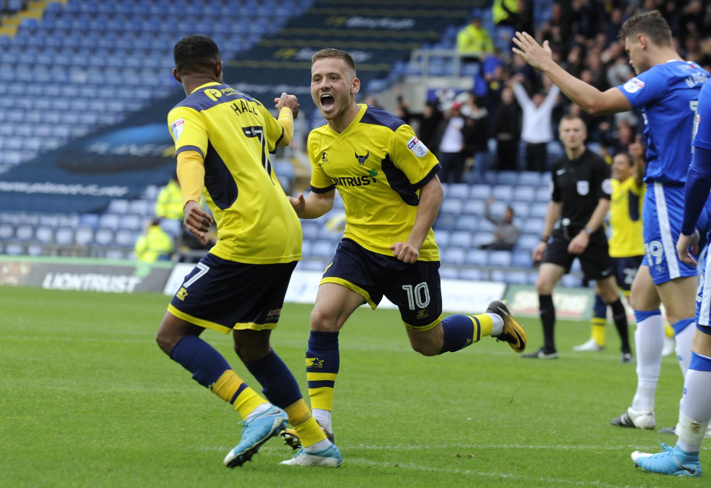 UP AND RUNNING: Jack Payne celebrates his goal – Oxford United's first of the afternoon – in Saturday's impressive win over Gillingham Picture: David Fleming