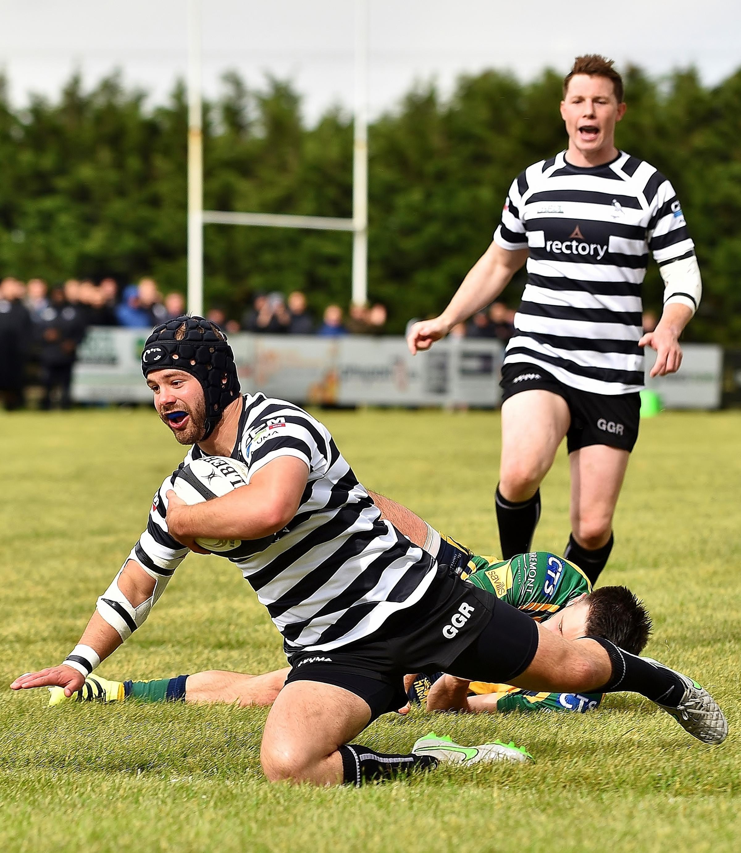 JOY: Henry Lamont cannot hide his delight as he dives over to score Chinnor's third try against Henley Hawks Picture: Aaron Bayliss