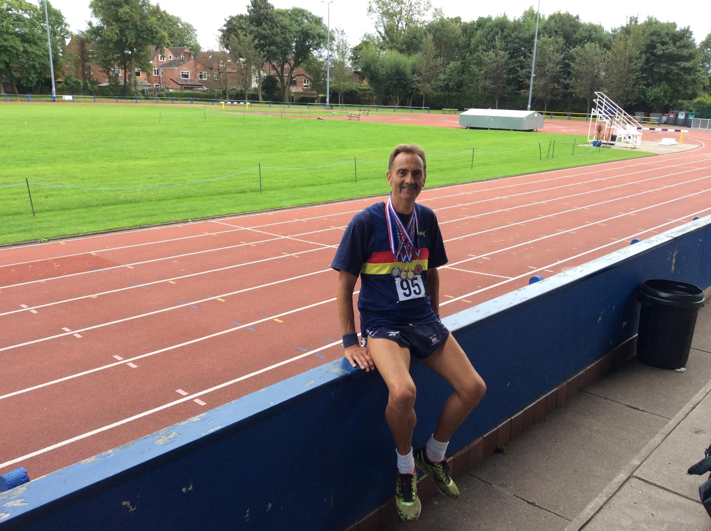 Abingdon's Duncan Talbot with his medals at the Longford Park Stadium in Manchester