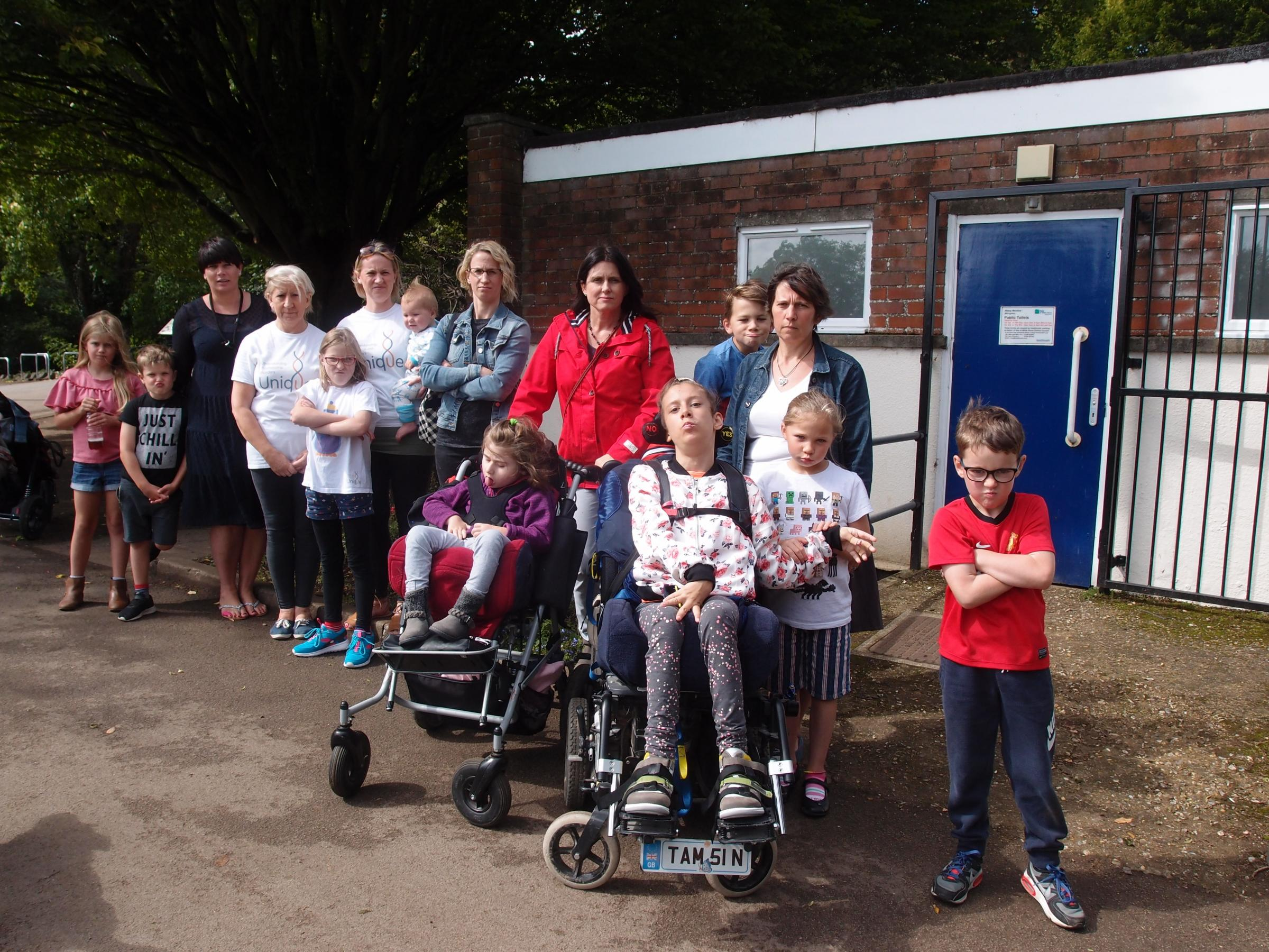 Campaigners outside the current Abbey Meadow toilets.